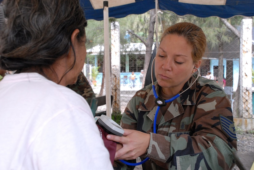 CUESTA DE LA VIRGEN, Honduras -- Air Force Tech. Sgt. Diane Strohm, Joint Task Force-Bravo Medical Element emergency medical technician, takes the blood pressure of a Honduran villager here Oct. 19.  This MEDRETE educated 785 Hondurans on preventive medicine issues such as hand washing, food preparation and personal hygiene.  Of those 785, doctors examined 352 patients and the dentist treated 139 patients. (U.S. Air Force photo/Tech. Sgt. Sonny Cohrs)
