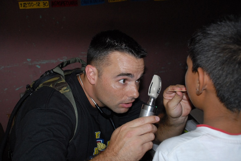CUESTA DE LA VIRGEN, Honduras -- Air Force 1st Lt. Damian Garza, a physician assistant with Joint Task Force-Bravo's Medical Element, examines a patient during a medical readiness training exercise here Oct. 19.  This MEDRETE educated 785 Hondurans on preventive medicine issues such as hand washing, food preparation and personal hygiene.  Of those 785, doctors examined 352 patients and the dentist treated 139 patients. (U.S. Air Force photo/Tech. Sgt. Sonny Cohrs)
