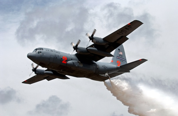 Two Air Force Reserve Command C-130 Hercules aircraft, equipped with Modular Airborne Firefighting Systems like this C-130 dropping water during annual MAFFS training in New Mexico, have been dispatched to help battle wildfires in California.  The aircraft are from the 302nd Airlift Wing at Peterson Air Force Base, Colo.  (U.S Air Force photo/Tech. Sgt. Rick Sforza)