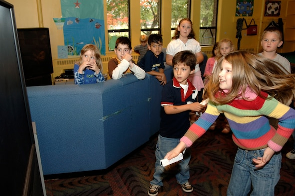 HANSCOM AFB, Mass. – Christian Ruiz (left) and Becky Peel go head to head during a Nintendo Wii ™ video game challenge during the Lights on Afterschool event that promoted the importance of Afterschool programs for youth. Activities included sports, a video game tournament, arts and crafts, a cooking activity and more. (U.S. Air Force photo by Jan Abate)
