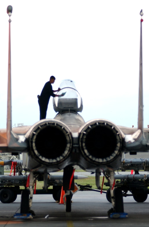 A maintainer from the 44th Aircraft Maintenance Unit cleans the canopy of an F-15C Eagle here before take-off Oct. 23.  The maintainers are supporting training missions based on real-world scenarios as part of Local Operational Readiness Exercise Beverly High 08-1. (U.S. Air Force photo/Tech. Sgt. Rey Ramon)