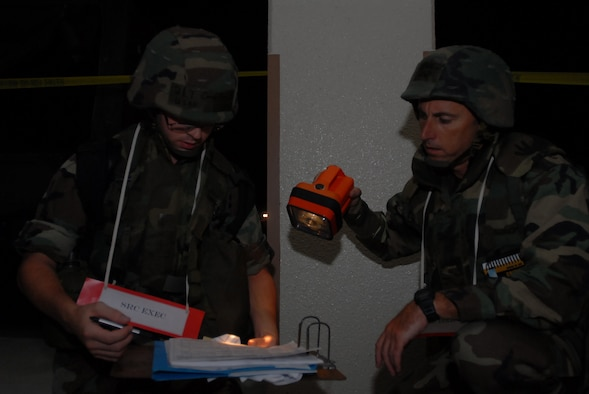 Second Lt. Corey Erickson, 18 Communications Squadron, and Lt. Col. Steven Kennedy, 18th Comptroller Squadron, account for personnel after their facility was evacuated during the Local Operational Readiness Exercise at Kadena Air Base, Japan, Oct. 24, 2007.  The Airmen are supporting training missions based on real-world scenarios as part of Local Operational Readiness Exercise Beverly High 08-1. (U.S. Air Force photo/Senior Airman Darnell T. Cannady)