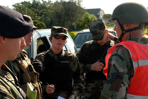 Air Force Office of Special Investigation agents get a briefing by the 18th Security Forces on scene commander during the Local Operational Readiness Exercise at Kadena Air Base, Japan, Oct. 23, 2007. In this scenario base agencies responded to a simulated car bomb.  (U.S. Air Force photo/Airman 1st Class Ryan Ivacic)
