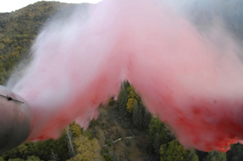 Fire retardant is deployed over a wildfire in North San Diego County, Calif., Oct. 24, 2007. Two specially equipped C-130 Hercules aircraft and crews from the Air Force Reserve's 302nd Airlift Wing, Peterson Air Force Base, Colo., are participating in the Southern California firefighting effort. (U.S. Air Force photo/Tech. Sgt. Roy A. Santana)