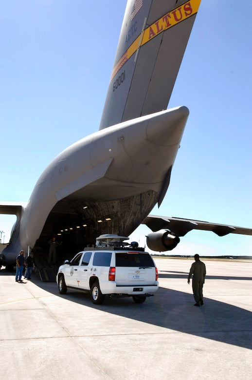 Members of the 97th Operations Support Squadron and the 58th Airlift Squadron load Soldiers and an Army emergency response vehicle onto a C-17 Globemaster III Oct. 24 at San Antonio. The emergency response vehicle is being airlifted to California to help support personnel battle the wildfires. Members of the 97th OSS and the 58th AS, as well as the C-17 are from Altus Air Force Base, Okla. The Army Soldiers and equipment are from U.S. Army North based at Fort Sam Houston in San Antonio. (U.S. Air Force photo/Tech. Sgt. Larry A. Simmons)