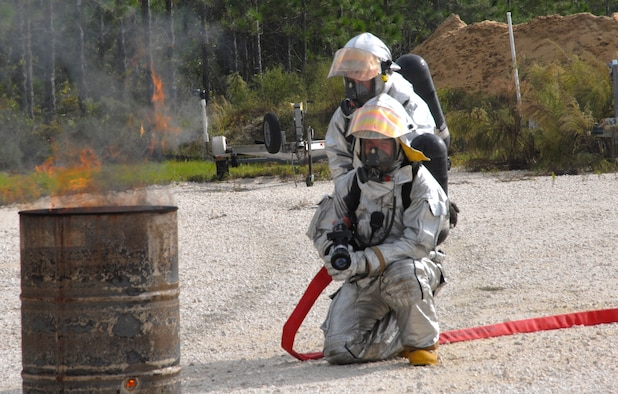 Tyndall Air Force Base firefighters battle a controlled and simulated F-15 crash site during an exercise in Mexico Beach, Fla. Oct. 23.  Also on scene were first responders from Mexico Beach and Port St. Joe, Fla. (U.S. Air Force photo/Susan Trahan)