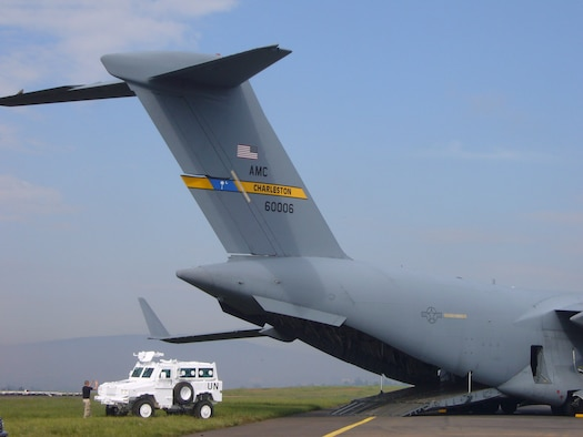 Airmen from the 786th Air Expeditionary Squadron loaded United Nations armored personnel carriers onto C-17s en route to the Darfur region of Sudan Oct. 24 at Kigali International Airport in Kigali, Rwanda .