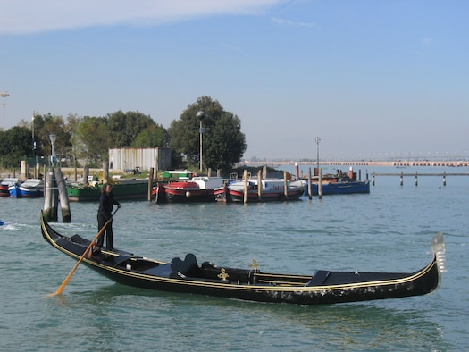 AVIANO AIR BASE, Italy--Alex Hai, a female gondolier in Venice, test drives Mr. Manley's gondola round a pier Oct. 19 in Venice. Miss Hai declared the gondola sea-worthy amid cheers, clapping and high fives of Mr. Manley's friends and family. (Photo by Jim Sajo)