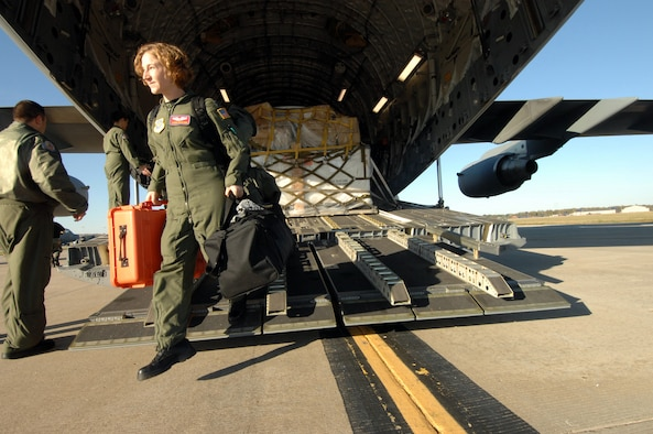 Members of the 375th AES arrive home at Scott AFB, IL as they exit a C17A Globemaster from 452nd AMW, March Air Reserve Base, Calif. The 375th AES was assigned to the Mobile Aeromedical Staging Facility at March Air Reserve Base, Calif., in support of medical relief efforts for the California wildfires. The 375th along with other aeromedical components from Pope AFB, N.C., and Travis AFB, Calif., were on standby to air-evacuate fire victims out of the local area. U.S. Air Force photo by MSgt Rick Sforza (RELEASED)