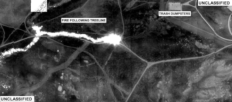 An infrared image, taken by an RQ-4 Global Hawk Unmanned Aerial vehicle and analyzed for Southern California Firefighters, shows the Horno Fire progressing from left to right with hot areas and objects as white on a darker background. (U.S. Air Force photo)