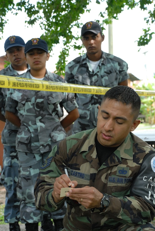 SOTO CANO AIR BASE, Honduras -- Air Force Staff Sgt. Edgar Castro, Joint Security Forces, logs simulated evidence during a training class with police from nearby Comayagua and La Paz police divisions, as well as cadets from the La Paz Police Academy.  The crime scene processing course is one in a series of classes taught this year, with other lessons involving handcuff procedures, high-risk traffic stops and riot control.  (U.S. Air Force photo/Tech. Sgt. Sonny Cohrs)