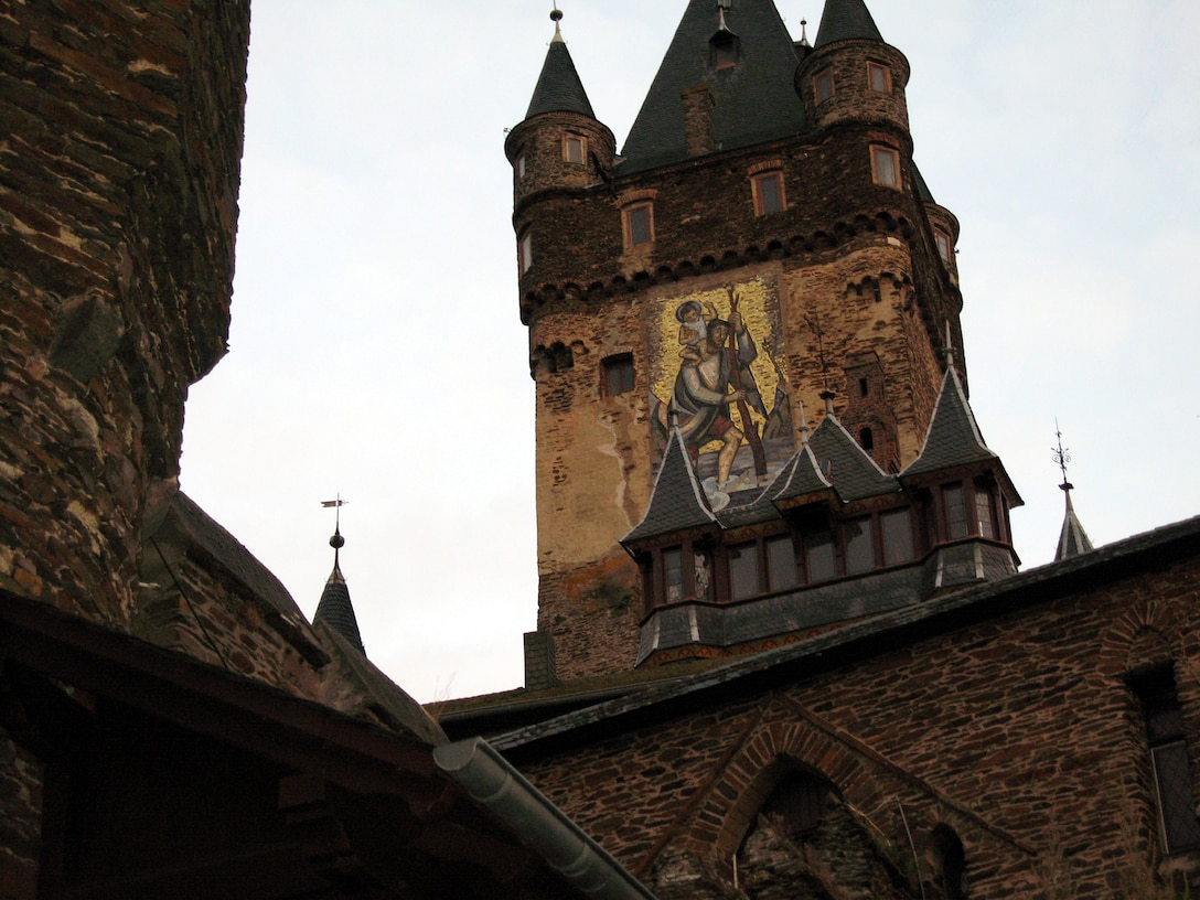 SPANGDAHLEM AIR BASE, Germany – A mural of St. Christopher, the patron saint of travelers, painted on the side of Cochem Castle, greets visitors as they make the walk to the castle. The Information, Trips and Travel office offers a Cochem Castle tour and medieval dinner Nov. 24. (U.S. Air Force photo/Staff Sgt. Tammie Moore)