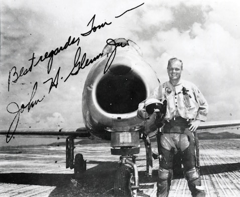 Wearing combat survival gear, John Glenn stands in front of his F-86F. The original photograph was autographed by Glenn to Tom Bartlett, an enlisted man in the 1st Marine Aircraft Wing who took the photo at K-3 airfield, Korea. (U.S. Air Force photo)