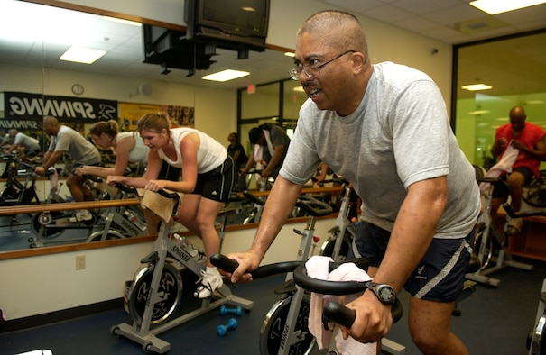 Master Sgt. David Domingo, 36th Contingency Response Group, participates in the spin portion of the Halloween Aerobithon Oct. 31, which consisted of back to back aerobic classes held in the Coral Reef Fitness Center.  The aerobithon also consisted of prizes and refreshments for participants. (U.S. Air Force photo/Senior Airman Miranda Moorer)