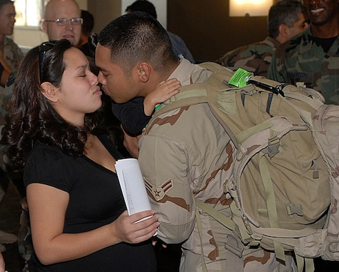 Airman 1st Class Solomon Quitugua, a patrolman with the 21st SFS, kisses his wife Mecaila at the Colorado Springs airport. Twenty-one Airmen from the 21st SFS returned from Afghanistan Oct. 29. (U.S. Air Force photo by Rob Lingley)