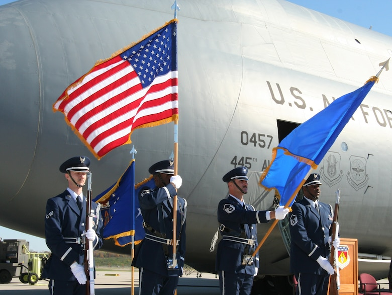 "WRIGHT-PATTERSON AFB, Ohio - 445th Airlift Wing Honor Guard posts the colors at the C-5 Dedication Ceremony to dedicate Aircraft 70-0457 ""City of Fairborn - First Schoolhouse of Aviation"".  The ceremony was held to unveil the nose art on the C-5. (U.S. Air Force photo/Senior Airman Ken LaRock)"