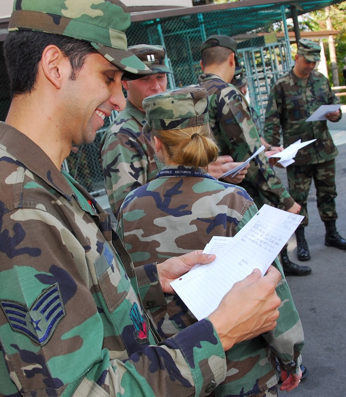 OSAN AIR BASE, Republic of Korea --  Staff Sgt. Chris Cugier, 607th Air Operations Center, reads a letter from his new 2nd grader pen pal Oct. 26. Tech. Sgt. C.J. Baker, 607th Air Intelligence Squadron, and Veronica Flowers, a teacher at Delmae Heights Elementary School in Florence, S.C., created a program in which her students and Osan Airmen will be pen pals for one year. (U.S. Air Force photo by Staff Sgt. Ronnie Hill)