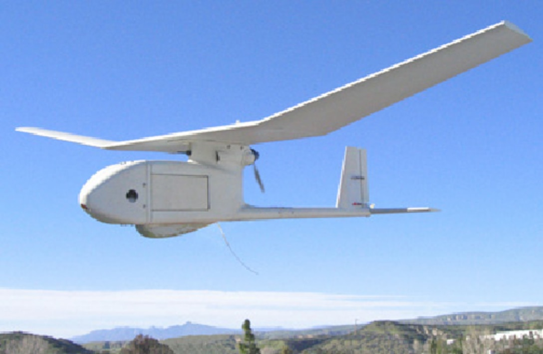 The RQ-11 Raven Small Unmanned Aircraft System in flight. (courtesy photo)