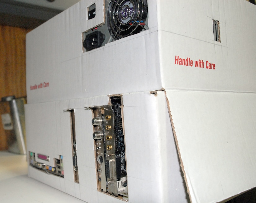 """SOTO CANO AIR BASE, Honduras -- This """"Frankenstein computer"""" was built from spare parts and a few shipping boxes by Tech. Sgt. Robert Russell, Armed Forces Network Honduras chief engineer.  The computer took about two weeks to build, since he had to wait on the glue to dry and cure after each computer component was added.  (U.S. Air Force photo/Tech. Sgt. Sonny Cohrs)"""