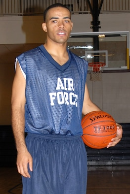 """BUCKLEY AIR FORCE BASE, Colo. -- Corneilius Holloway, 96th Medical Group, is trying out for the Air Force basketball team. Holloway, who is trying out for the first time with the team, is striving to make the team and thinks he can contribute solid play from the point guard position. Growing up emulating Michael Jordan and admiring Carmelo Anthony as basketball heroes has sparked a love for the competition of the game. The coach's first assessment of his basketball skills is """"He's a natural leader. A good point guard."""" (U.S. Air Force photo by Airman 1st Class Randi Flaugh)"""