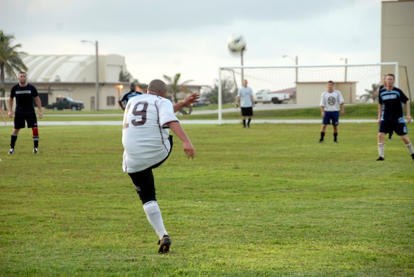 ANDERSEN AIR FORCE BASE, Guam - A Helicopter Sea Combat Squadron TWENTY-FIVE player fields a penalty kick against the 36th Communications Squadron intramural soccer team Aug. 28 at Andersen's soccer field.  HSC-25 won 4-2.  (Photo by Airman 1st Class Daniel Owen/36th Wing Public Affairs)