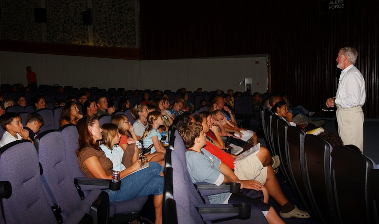 Ken Wooden, renowned speaker and child sexual abuse expert, speaks to families in the Keystone Theater on Kadena Air Base, Japan, Aug. 27, about sexual predators and the lures they use to trap child and young adult victims.  Mr. Wooden travels around the world educating children and their families about being proactive to counter sexual predators.  He has also made a variety of television appearances, including the Oprah Winfrey Show.   (U.S. Air Force photo/Tech. Sgt. Reynaldo Ramon)