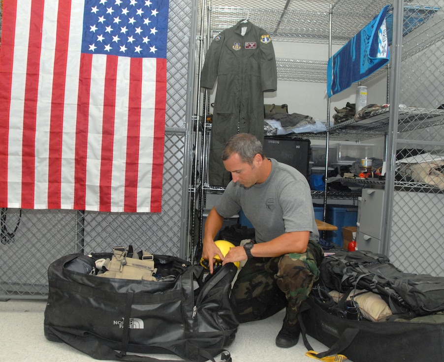 Air Force Reservist Staff Sgt. Patrick Dunne, 308th Rescue Squadron pararescueman, Patrick Air Force Base, Fla.,finishes up packing in preparation for his trip to Oregon where he will assist in the recovery of two climbers on Mt Hood who were never found in a search and rescue effort Dec. 2006. (Air Force photo/Master Sgt. Chance C. Babin)