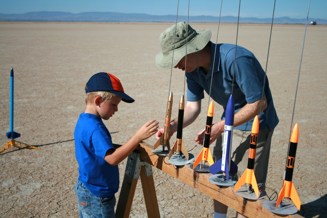 Logan Rotramel, a Cub Scout from pack 741, assists Capt. Stephen Leggario, Cub Scout leader, during a recent rocket lauch on the Rosamond Dry Lake. The rocket launch is one of many activities the Cub Scouts participate in throughout the year to have fun and earn merit badges. (Courtesy photo)