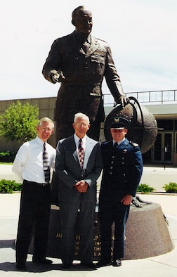 U.S. AIR FORCE ACADEMY, Colo. -- David, Don and Justin White stand proudly at Justin's graduation from the Air Force Academy in 2000. Each of the three men has ties to Air Force heritage: Don was a B-24 pilot for the Army Air Corps, David was assigned to the 50th Tactical Fighter Wing at Hahn Air Base, Germany, and now-Captain Justin White is chief of orbital safety for the 50th Space Wing at Schriever Air Force Base, Colo. (photo courtesy of Capt. Justin White)