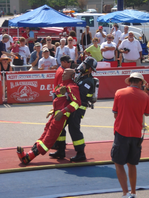 Staff Sgt. Cory McGee, 509th Civil Engineer Squadron, drags a 175-pound rescue mannequin toward the finish line at the Scott Firefighter Combat Challenge at Omaha, Neb., Aug. 18-19. Sergeant McGee, who was part of a three-man firefighting team from Whiteman, won first place in the five-part competition, and answered his winning performance with another victory the following weekend at Sioux Falls, S.D., Aug. 23-26. (Photo printed with permission of Staff Sgt. Joshua Miller)