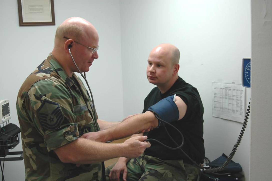 Master Sgt. Perry Campeau (left) non-commissioned officer in charge of Aerospce Medicine Flight, does a routine blood pressure check on patient Master Sgt. Kevin Kosal. The AMDF is tasked to keep the 927th Air Refueling Wing Airmen mission ready at all times. (U.S. Air Force photo/Staff Sgt. Kevin Tomko)