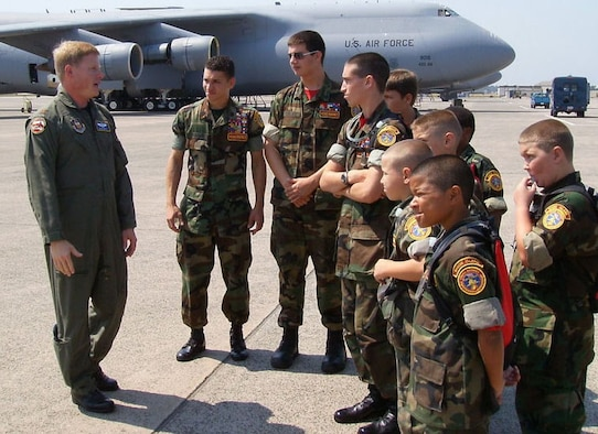 Maj. David Smith, a C-5 pilot with Westover's 439th Operations Support Squadron, explains the mission of the airlifter to members of the Rhode Island Young Marines during a recent base tour. (US Air Force photo by Staff Sgt. Evelyn Albarran)