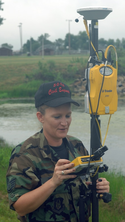 WHITEMAN AIR FORCE BASE, Mo. --  Staff Sgt. Clara Winkler, 509th Civil Engineer Squadron, measures elevation around the base lake with GPS surveying equipment Sept. 6. Winkler is a Reservist from the 442nd Fighter Wing currently on active duty with the 509th CES. (U.S. Air Force Photo/Tech. Sgt. Samuel A. Park)