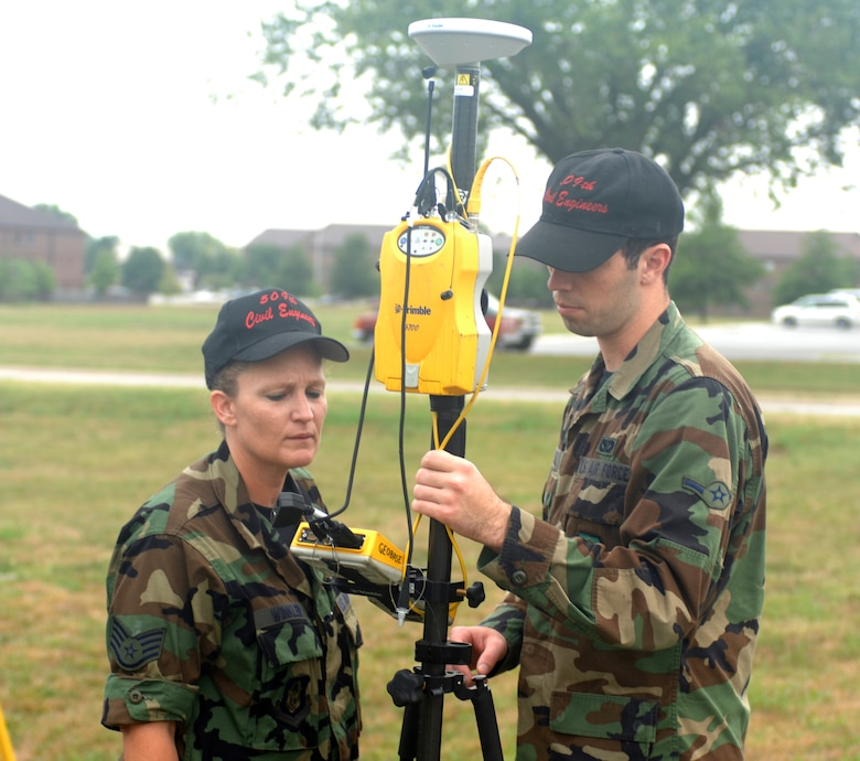 WHITEMAN AIR FORCE BASE, Mo. --  Staff Sgt. Clara Winkler and Airman Geoffrey Russel, 509th Bomb Wing Civil Engineer Squadron, set up a Trimble 5700 to survey numerous points around Skelton Lake Sept. 6. The information will be used to determine if a lake improvement project is possible. Winkler is a Reservist from the 442nd Fighter Wing currently on active duty with the 509th CES. (U.S. Air Force Photo/Tech. Sgt. Samuel A. Park)