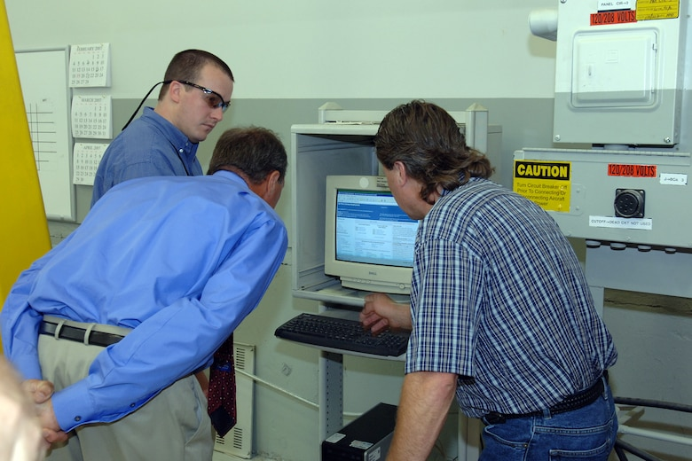 HILL AIR FORCE BASE, Utah-- Mr. Don Cazel, executive director for the Ogden Air Logistics Center, along with two unidentified workers, is shown one of Hill Air Force Base's newest kiosks located in high traffic areas for wage grade employees to use. Hill AFB recently installed 57 kiosks for employees to use for official work-related issues. (U.S. Air Force photo by Alex R. Lloyd)