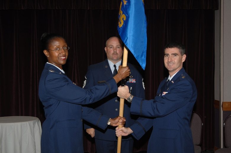WHITEMAN AIR FORCE BASE, Mo. - Left: Col. Gloria Twilley, 509th Medical Group commander, passes the guidon of the 509th Medical Operations Squadron to Lt. Col. Brian Stanton during an assumption-of-command ceremony Sept. 7. Colonel Stanton was previously assigned to the 6th MDG at MacDill Air Force Base, Fla. Lt. Col. Jeffery Johnson, the former 509th MDOS commander, has moved on to the U.S. Air Force Academy. (U.S. Air Force photo/Senior Airman Lauren Padden)