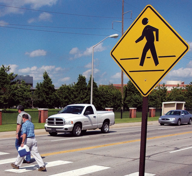 According to Oklahoma state law, pedestrians who do not use a crosswalk must yield the right of way to vehicles. Pedestrians should always make eye contact with drivers before crossing the street. (Air Force photo by Margo Wright)