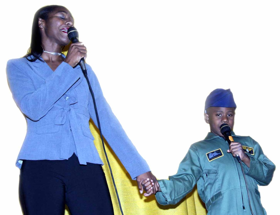 "Nekia and Adama Mbaye took first place in the parent and youth category of last year's Family and Teen Talent Contest with their version of ""I Believe I Can Fly."" (Air Force photo by Becky Pillifant)"