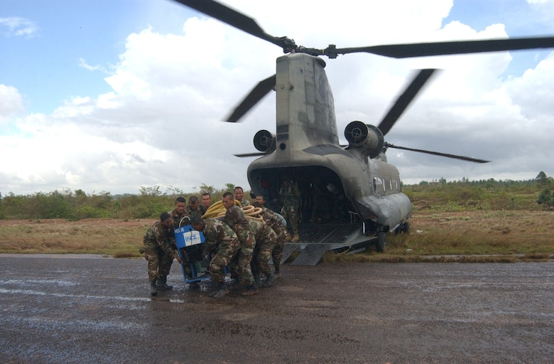 PUERTO CABEZAS, Nicaragua -- Members of the Nicaraguan army offload relief supplies from a CH-47 Chinook helicopter here Sept. 7.  A team from Joint Task Force-Bravo in Honduras is deployed to Nicaragua supporting relief efforts following landfall of Hurricane Felix.  U.S. Air Force photo by Tech. Sgt. Sonny Cohrs