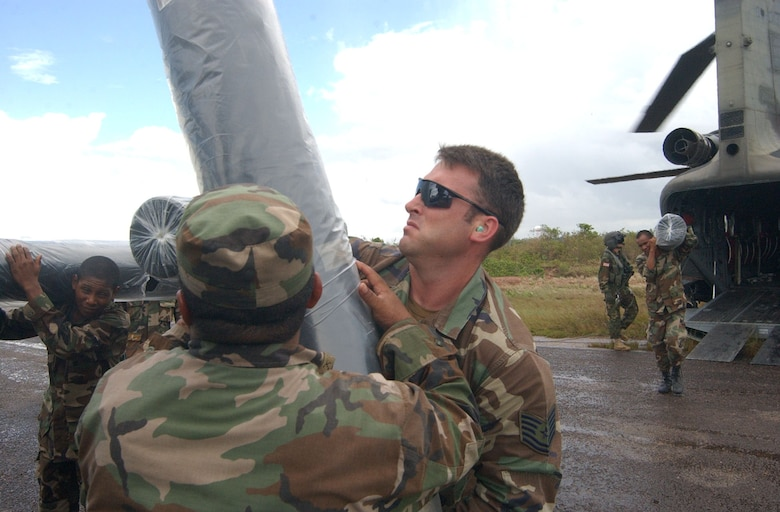 PUERTO CABEZAS, Nicaragua -- Air Force Tech. Sgt. Jeffrey Scott, a communications specialist deployed to Soto Cano Air Base, Honduras, from Pope AFB, N.C., loads relief supplies onto a truck here Sept. 7.  Sergeant Scott is part of the team from Joint Task Force-Bravo in Honduras deployed to Nicaragua supporting relief efforts following landfall of Hurricane Felix. U.S. Air Force photo by Tech. Sgt. Sonny Cohrs