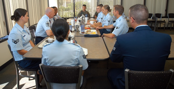 SCHRIEVER AIR FORCE BASE, Colo. -- Chief Master Sgts. Thomas Narofsky, Clarence Moore and Valise Godley share lunch and mentorship with Schriever Airmen during Chief Narofsky's visit to Schriever Sept. 6. Chief Narofsky focused his discussion with Airmen on the Airmen's Creed and on planning their careers with long-term goals in mind. Chief Narofsky is the 14th Air Force command chief master sergeant; Chief Moore is 50th Space Wing command chief, and Chief Godley is the 50th Mission Support Group superintendent. (U.S. Air Force photo/Staff Sgt. Don Branum)
