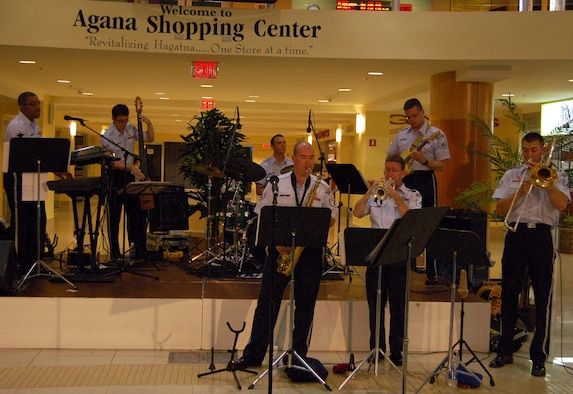 Members of the Air Force Band of the Pacific's Alaskan Express perform at the Agana Shopping Center Sept. 6 during Air Force Week. The Alaskan Express has performed at various locations around Guam, including Chamorro Village Sept 5. The band will also play during Andersen's Air Force Ball at Hilton Guam Resort and Spa Sept. 8.  Air Force Week's purpose is to raise public awareness of the service's operations and capabilities, showcase its Airmen, and thank local citizens for their heartfelt support of its men and women over the Air Force's 60-year history.