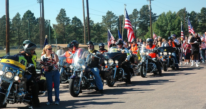 FORT CARSON, Colo. -- Members of the Patriot Guard motorcycle group lead a group of walkers during Colorado's second annual Freedom Walk. Approximately 1,500 people turned out for the event, which also featured guest speakers and entertainment. (U.S. Air Force photo/Lorna Gutierrez)