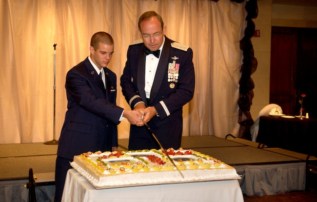 ANDERSEN AFB, GUAM -- Guest speaker, Lt. Gen. David Deptula, U.S.A.F. Deputy Chief of Staff for Intelligence, Surveillance and Reconnaissance, cuts the cake with the lowest ranking Airman in the room during the Air Force 60th Birthday Ball at Hilton Guam Resort on Sept. 8, 2007.  The ball was the final event of the Guam's Air Force Week. Air Force Week's purpose was to raise public awareness of the service's operations and capabilities, showcase its Airmen, and thank local citizens for their heartfelt support of its men and women over the Air Force's 60-year history. 