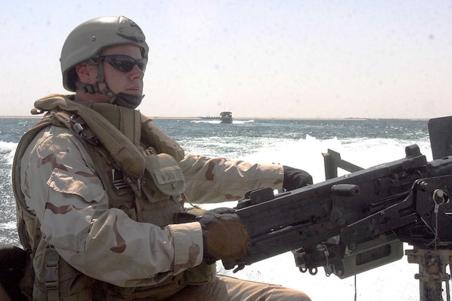 HADITHA DAM, Iraq, (Sept. 16, 2007) – Navy Petty Officer 1st Class Joshua L. Jackson, an aft (rear) gunner with Detachment 3, Riverine Squadron 1, Riverine Group 1, Navy Expeditionary Combat Command, in support of Regimental Combat Team 2, scans the waters during a curfew enforcement patrol on the Euphrates River near the dam. The regiment declared the temporary 24-hour curfew on the waterway to stem the suspected increase of enemy activity on the river during the Muslim holiday of Ramadan. Official Marine Corps Photo By Cpl. Ryan C. Heiser.