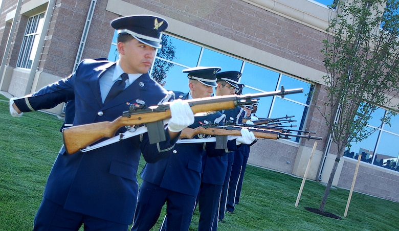 BUCKLEY AIR FORCE BASE, Colo. - Airman 1st Class Jeremy Ford and six other Buckley Honor Guard members render a 21-gun salute to the victims of Sept. 11, 2001 during Buckley's Patriot Day ceremony.   The base remembered the 6th anniversary of 9/11 with a formal Retreat ceremony, a moment of silence, a 21-gun salute and the playing of Taps. Members of the 460th Mission Support Group, Operations Group and Medical Group made up the formation for the ceremony. Col. Wayne McGee, 460th Space Wing commander, provided remarks. (U.S. Air Force photo by Senior Airman Jacque Lickteig)