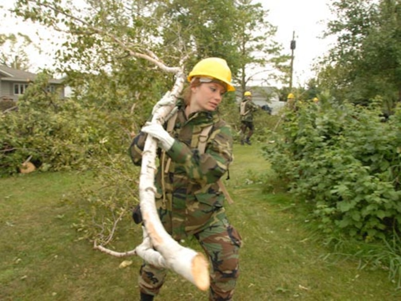 U.S. Air Force Staff Sgt. Sarah A. Ford, of the 119th Wing, removes fallen tree branches and debris from yards in order to clear a path for power line workers in Northwood, N.D., Aug. 28, 2007. A Fujita scale F-4 tornado that hit the city on Aug. 26, 2007 caused the damage. (U.S. Air Force photo by Senior Master Sgt. David H. Lipp) (Released)