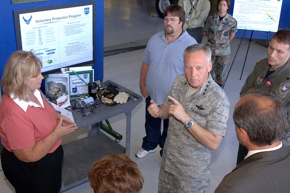 Gen. Bruce Carlson, commander of Air Force Materiel Command, talks to Don Cazel, Ogden Air Logistics Center deputy director, about Hill Air Force Base's Voluntary Protection Program. (U.S. Air Force Photo by Alex R. Lloyd)