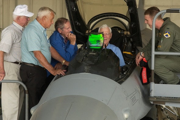 KUNSAN AIR BASE, South Korea - Captain Cesar Orozco, a pilot from the 35th Fighter Squadron, shows retired Lt. Gen. Charles Cleveland the functions of the F-16C Sept. 11. The veterans from the Korean War era visited Kunsan where they shared their experience with 8th Fighter Wing Airmen. (U.S. Air Force photo/Senior Airman Giang Nguyen)