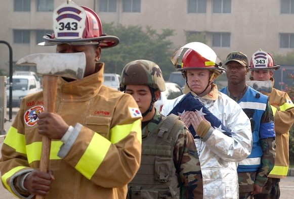 KUNSAN AIR BASE, South Korea -- Airmen from the base fire department, 8th Medical Group and 8th Security Forces Squadron, formed the colors team for the Sept. 11, 2001 remembrance ceremony here Tuesday. The ceremony marked the 6th anniversary of the terrorist attacks in New York City, the Pentagon and Shanksville, Pa. (U.S. Air Force photo/Senior Airman Steven R. Doty)